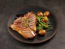 Freshly grilled T bone steak royalty free stock photography