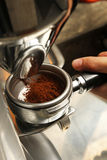 Freshly grinded coffee being emptied onto coffee holder - Series 2 Stock Photos