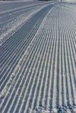 Freshly groomed ski piste backdrop vertical Royalty Free Stock Images