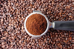Freshly ground coffee beans in a metal filter Royalty Free Stock Image