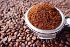 Freshly ground coffee beans in a metal filter Royalty Free Stock Photo