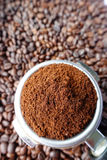 Freshly ground coffee beans in a metal filter Stock Images