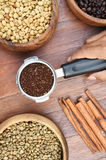 Freshly ground coffee beans in a metal filter and coffee beans with cinnamon Royalty Free Stock Image
