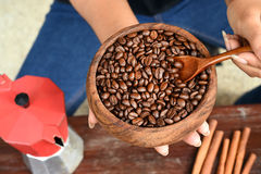 Freshly ground coffee beans in a metal filter and coffee beans with red kettle Stock Photos