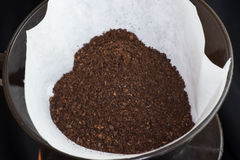 Freshly ground coffee in a filter Royalty Free Stock Photo