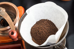 Freshly ground coffee with a mill or grinder Royalty Free Stock Photography