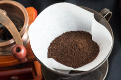 Freshly ground coffee with a mill or grinder Royalty Free Stock Images