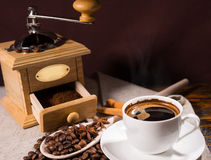 Freshly ground coffee in open wooden grinder Stock Images