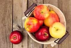 Apples in a basket, above view on rustic aged wood Stock Photos