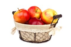 Apples in a rustic basket isolated on white Stock Photo