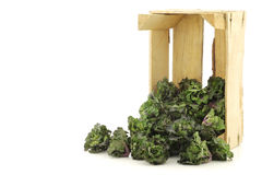 Freshly harvested kale sprouts in a wooden crate Royalty Free Stock Photo