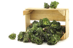 Freshly harvested kale sprouts in a wooden crate Stock Photo