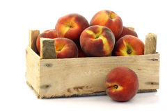 Freshly harvested peaches in a wooden crate Royalty Free Stock Photo