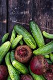 Freshly harvested pickling cucumbers and beetroots on dark rusti Royalty Free Stock Photo