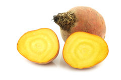 Freshly harvested yellow beet and two halves. On a white background Royalty Free Stock Photography