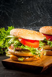 Freshly homemade burgers royalty free stock photography