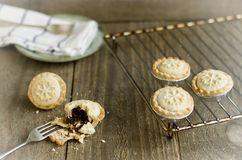 Freshly homemade mince pies  on a cooling rack. Christmas tradit Stock Photo