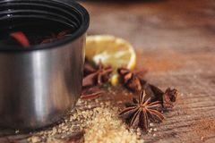 Freshly homemade mulled wine in a bowl with fragrant species, citrus fruits, lemon on a wooden rusric board. Close up. stock images