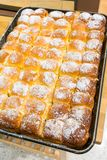 Freshly hot baked butter bread on tray sprinkle with icing sugar Stock Image