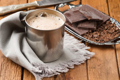 Freshly hot chocolate with foam in a tin mug Royalty Free Stock Photo