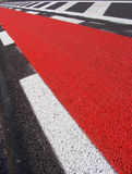 Freshly laid asphalt road with red bicycle path Stock Photos