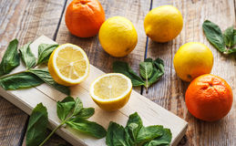 Freshly lemons and oranges on wooden boards Royalty Free Stock Images