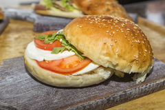 Freshly made clubsandwich with mozzarella tomato and salad Stock Photography