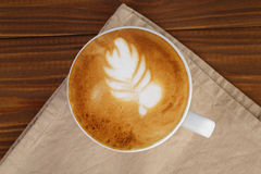 Freshly made cup of cappuccino with leaf art Stock Images