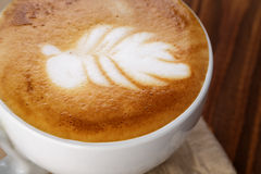 Freshly made cup of cappuccino with leaf art Royalty Free Stock Images