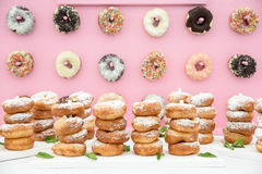 Freshly made doughnuts. Freshly baked doughnuts in composition on pink wall Stock Photography