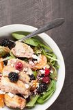 Spinach salad with fruit and feta cheese above shot Royalty Free Stock Photos
