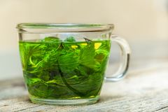 Mint tea on the table. Freshly made mint tea on the wooden table royalty free stock photography
