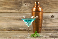 Freshly made Mixed Drink with Mint on Weathered Wood Royalty Free Stock Photo