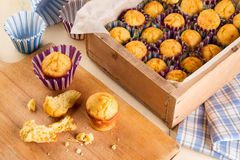 Freshly made muffins on kitchen table stock images