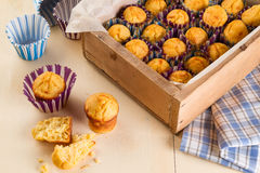 Freshly made muffins on kitchen table Royalty Free Stock Photos