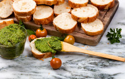 Freshly made pesto and sliced bread on server Stock Image