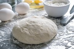 Pizza Bread Dough. Freshly made pizza bread dough on a stainless steel counter top royalty free stock image