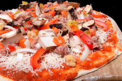 Freshly made pizza ready to be baked Royalty Free Stock Photos