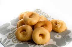 Freshly Made Plain Donuts on a Table Royalty Free Stock Image
