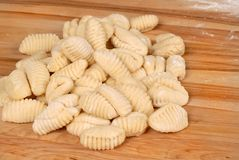 Freshly made potato gnocchi on a cutting board Stock Photo