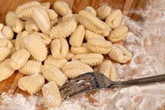 Freshly made potato gnocchi on a floured cutting board Royalty Free Stock Photos