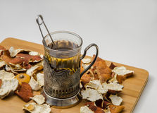 Freshly made tea in retro glass cup Royalty Free Stock Photo