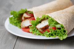 Freshly made tortilla wraps with chicken and vegetables Stock Image