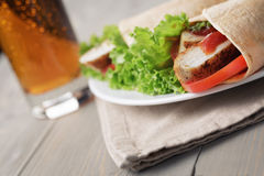 Freshly made tortilla wraps with chicken and vegetables Stock Photo