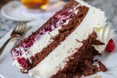 Black Forest Cake in Germany. Freshly made traditional black forest cake with chocolate sponge, whipped cream and cherries Royalty Free Stock Photo