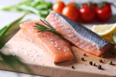 Freshly marinated salmon fillet. On wooden cutting board Stock Photos