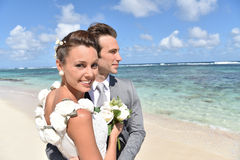 Freshly married couple on caribbean beach Royalty Free Stock Photo