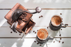 Freshly milled coffee with beans Royalty Free Stock Photography