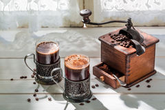 Freshly milled ground coffee and old grinder Royalty Free Stock Images