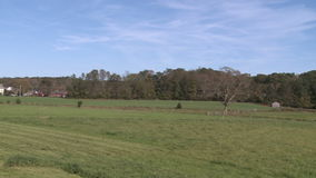 Freshly mowed farm land stock footage